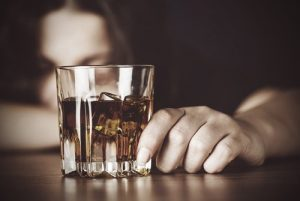 - woman in front of alcohol glass feature image alcohol abuse 300x201 - Αιθανόλη